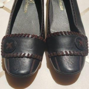 Delman black flats with brown stitching, 11M